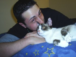Justin was with us when we picked up Boo from PetSmart on St. Patricks Day in 2005. Despite the allergic reactions and the insanity-inducing U-haul ride, I'm convinced there's still a small part of Justin's heart reserved for Boozer