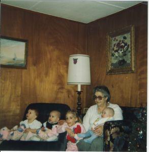 Rhea, Emily, Sarah, Memere holding Justin - Christmas 1983